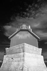 Grand Haven Lighthouse (DJ Wolfman) Tags: blue red blackandwhite bw lighthouse lake water michigan lakemichigan michiganfavorites grandhaven michiganlighthouses grandhavenmi