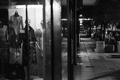 The line 3. (df-stop.) Tags: street city urban blackandwhite reflection tree glass metal shop night canon concrete dummies display pavement empty clothes greece thessaloniki division consumerism timeless theline makedonia vitrin womensclothes  macedoniagreece eurocrisis dfstop
