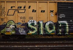 SION (TheGraffitiHunters) Tags: graffiti graff spray paint street art colorful freight train tracks benching benched sion character spit boxcar