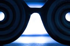 Hipnotized--HMM! (amarilloladi) Tags: hypnoglasses macromondays hypnotism glasses backlit