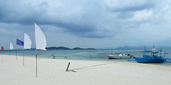 The beauty of the Philippines (austinjosa) Tags: tropics tropical bangka island codon palawan philippines sea flags beach nature clouds awesome paradise woohoo