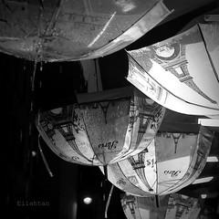 Essuie tes larmes... (nathaliedunaigre) Tags: paris umbrellas view vue street pluie rain carré square bw blackwhite nb noiretblanc monochrome nuit night toureiffel eiffel tower