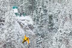 Winter Ziplining (Newfoundland and Labrador Tourism) Tags: western winter snow ziplining zip lining fun man guy person air sky yellow coat trees marble mountain tours