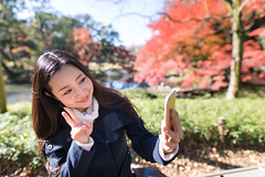 Japanese woman taking selfie shot in park (Apricot Cafe) Tags: img6812 30s asianethnicity japan japaneseethnicity sigma20mmf14dghsmart tokyo autumn autumnleaves beautyinnature change charming cheerful enjoying foliage freshness happiness hope japanesefallfoliage japanesemaple leaves mapleleaf nature oneperson onlywomen orange outdoors park people red refreshing selectivefocus selfie smiling sunlight takingpictures tranquility traveldestinations tree walking woman youngadult