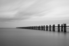 A look back, Out to Sea, East Beach (Geraint Rowland Photography) Tags: longexposure blackandwhite bw water weather clouds canon pier seaside posts drift breakwater eastbeach geraintrowlandshoeburynessphotography
