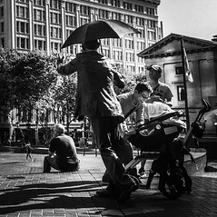 Umbrella Man (TMimages PDX) Tags: street city people urban statue bronze square portland geotagged photography photo image streetphotography explore photograph fineartphotography flickrexplore explored iphoneography