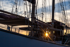 Shining (haddartist) Tags: sunset sky sun colors lines silhouette closeup clouds contrast evening virginia boat cabin colorful ship patterns norfolk sails vessel highlights fabric flare sail rays ropes nautical hull tallship masts silhouetted waterside rigging lifepreserver americanrover