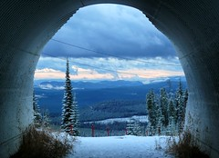Through the tunnel (Eddie the Explorer) Tags: canada bc britishcolumbia tunnel mountains snow trees winter bigwhite sunset