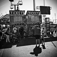 Tickets (colinpboyd) Tags: street arizona urban blackandwhite bw child statefair streetphotography streetphoto ricohgr bnw blackandwhitephotography