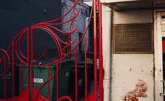 A Colorful Gate at the Surratt House (John Bense) Tags: red house fence washingtondc gate chinatown abrahamlincoln assassination marysurratt