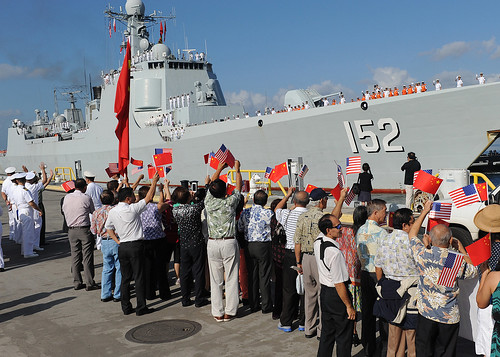 Chinese citizens wave flags as the Peopl by Official U.S. Navy Imagery, on Flickr