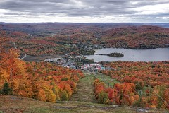 The foliage of the Laurentians (beyondhue) Tags: mont tremblant ski hill mountain resort village laurentians fall autumn landscape laurentides quebec beyondhue travel trees foliage red orange yellow lake lac