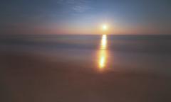 Calming Things Down (iShootPics) Tags: goldenhour sunrise calm serene water minimal starburst smooth calming sun minimalism longexposure dreamy layers pretty tones beach light sunny bright sony a7r zeiss