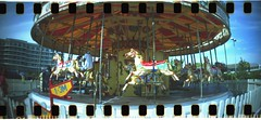 Timeless carousel (Simon in Southend) Tags: carousel horse ride fareground butlins bognoregis merrygoround classic timeless oldfashioned film analogue lomo lomography sprocket holes sprocketrocket rocket pano panorama uk fun funfare funfair wide wideangle 35mm