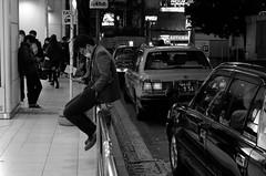 Taxi Pool (hidesax) Tags: taxi pool man taxis sitting rail mobile phone shinjuku tokyo japan hidesax leica x vario