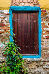 Old wooden blue framed door (yuliakupeli) Tags: aegean architecture attraction blue bougainvillea buildings cityscape europe flowers green hibiscus narrow nobody old outdoor plant shrubs sky small sunny town traditional travels village vine walls