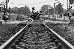 Level crossing, Lopburi, Thailand (Lee @ My Favourite Lens) Tags: street travel monochrome lines train thailand photography monkey town asia track crossing sony 55mm level motorcycle f18 lopburi macaque supertakumar nex