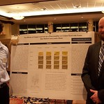 Ben Walters and Justin Shaw posing with their research poster.