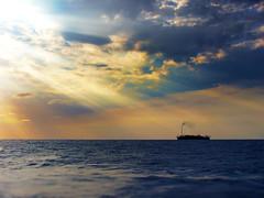 FPSO and Sunrays (Rodrigo Neves) Tags: ship offshore sea mar seascape sun sunset sunrays clouds vessel ocean brasil brazil microsoft panasonic lumix dmclz3