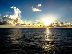 double sun reflection (-gregg-) Tags: reflection clouds ocean sun cruise