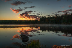 Misty Sunrise (G. Russell Jennings) Tags: yellow sunrise lake clouds rocks trees water pond mirror grass leaf mist outdoors landscape reflection
