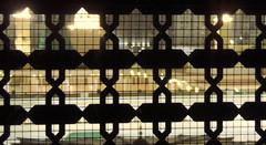 During The Night (Khaled M. K. HEGAZY) Tags: nikon coolpix p520 madinah ksa kingdomofsaudiarabia indoor closeup yellow white black islam mosque masjid woodwork arabesque window المدينة المملكةالعربيةالسعودية
