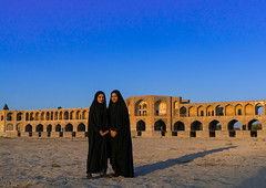 Portrait of two young women in chadors in front of khaju bridge pol-e khaju, Isfahan province, Isfahan, Iran (Eric Lafforgue) Tags: 20s 2people ancient arches architectural architecture attraction blue bricks bridge chador clearsky colorimage copyspace day dried esfahan fullframe fulllength hispahan horizontal iran iranian isfahan ispahan khajubridge lookingatcamera middleeast muslim orient outdoors persia photography river spadana sunny tourism touristic traveldestinations twopeople unescoworldheritagesite urban veiled women womenonly youngadults zayandeh isfahanprovince