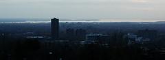Blue Haze (ETt_) Tags: haze mist atmosphere fog blue autmn montreal dark clouds river lac town landscape skyline grey
