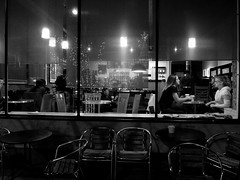 Coffee shop at night (pilechko) Tags: blackandwhite monochrome night lights reflections people street streetscenes streetphotography dark