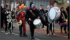 Spookport (* RICHARD M) Tags: street costumes music halloween musicians skeleton facepainting weird scary candid clown ghost performance musicmakers parades eerie spooky entertainment bands masks marching cloak macabre drumming marchingband performers drummers fancydress halloweenparade cymbals southport concertina gruesome cloaked merseyside halloweencostumes hooded marches marchers sefton entertainers bigdrum motleycrew skeletoncostume clowncostume concertinabands spookport maskedmarchers bootledistrictconcertinaband ghostlygathering