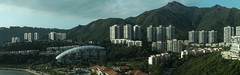 Hong Kong Against The Mountains (abdul / yunir) Tags: house mountain nature buildings landscape hongkong view scenic discoverybay publichousing sonyalphadslr