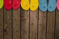 Multicolored flip flops on wooden deck (Jim Corwin's PhotoStream) Tags: abundance brightcolor casual closeup closeups color deck display easygoing enjoyment fashion flipfops footwear fun group groupofobjects horizontal leisureactivity multicolored nobody outdoors overheadview pair pattern patterns photography relaxation relaxing repetition row rows sandal sandals shoes sidebyside stack stacked stilllife summer thongs togetherness topview travel travelandtourism vacation vacations variation viewfromabove