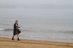 A girl on the beach (smir_001) Tags: fishingtown harbour fog seafog mist morning outdoor tourist beach sands sandbeaches weather september autumn scarborough northyorkshire england uk sea waves holidaymakers britishholiday canoneos7d searesort britishresorts girl woman strolling