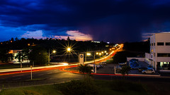 Lights running from the rain (Vincius_Fontes) Tags: nikon d3200 1855mm night road city cu cidade sky sun sol sunset silhouette rays rain storm light lights long exposure 18mm por do shadow carros cars