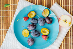 Flat blue dinner plate with plums, halves of apples (ddanilejko) Tags: photography food fruits sweet eat plum apples cut healthyeating colorimage vibrant vitamin useful organic blue yellow white woodtexture plate kitchentowel utout raw whole dieting nature nopeople ingredient summer autumn ripe vegetarianfood crosssection slice dessert indoors snack halved variation red napkin