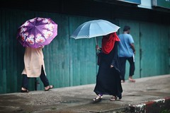Step into my colours (N A Y E E M) Tags: lady burqa umbrella pedestrians rain monsoon street laalkhanbazaar chittagong bangladesh windshield colors friday afternoon red