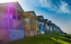 Remember Summer? (DobingDesign) Tags: whitstable kent beachhuts colours colourful solarflare seaside bythesea sky clouds colour jues bluesky mood row rooves huts feelgood outdoor shadows wood lensflare simplethings relax