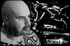 Bikers, tattoos and bikes. (CWhatPhotos) Tags: cwhatphotos dof depth field tattoo tattooed tattoos inked tribal chest shoulders selfee me photographs selfie have it photograph pics pictures pic picture image images foto fotos photography artistic that which contain digital dark portrait body upper torso tatt ink pose face look beard olympus em5 mk ii prime lens 45mm warrior curved curves bodyart 1979 classic yamaha 650 us custom special xs650 motorcycle biker motorbike