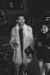Fur Coat Swag (L A Nolan) Tags: 185mmf28 28mmequiv bw blackandwhite fujifilmx70 fur furcoat monochrome newyork newyorkcity newyorknewyork night ny nyc outdoors outside soho thebigapple