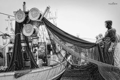 trawl (dim.pagiantzas | photography) Tags: trawl ships ship boats fishing fishermen nets workers men male sea grayscale monochrome outdoor canon seaport transportation seascape water