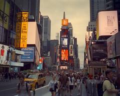 Times Square Near Dusk (Doha Sam) Tags: trip usa newyork film 35mm iso100 nikon fuji kodak manhattan olympus slidefilm scan midtown velvia empirestatebuilding positive analogue xa fe 800 manualfocus pocketcamera nikonscan tungstenbalanced cinemafilm coolscan9000ed 500t 800t cinestill vision3 samagnew smashandgrabphotocom linearscan educationleave wwwsamagnewcom