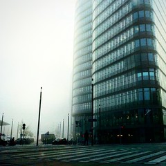 Early Morning Fog (hermez) Tags: vienna street city morning building silhouette fog architecture backlight skyscraper square austria trainstation squareformat iphone iphoneography instagramapp uploaded:by=instagram