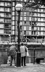 Beneath The Lamp (Geoff France) Tags: street streetphotography mono monochrome blackandwhite salfrod salfordquays lowry mediacentre streetmarket