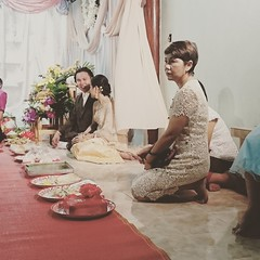 Thai Wedding (Shane Hebzynski) Tags: people thailand wedding ceremony chachoengao bride groom guests offerings indoors red desaturated
