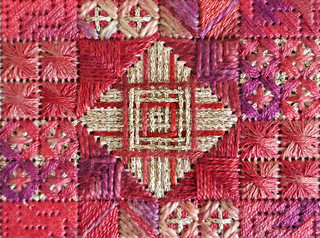 Fancy needlepoint stitching in reds and gold - Explored!