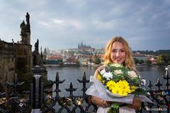 Kristna (Jan Lika) Tags: autumn sky flowers girl city buildings cloudy bridge woman smiling caucasian blonde river vltava prague railing