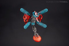 """Wyrm"" Slizer / Throwbot (Tymbal) Tags: throwbot slizer lego toy dragonfly dragon abstract 90s colourful lightbox lighting high contrast red teal wings throwing disk"