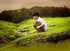 Grassland (TasveerByTaru) Tags: light boy portrait people baby india color art girl smile face by kids contrast canon dark children outdoors photography rebel 50mm photo kid interesting toddler infant colorful exposure photographer dof child image photos bokeh candid delhi indian young picture lifestyle naturallight pic laugh mumbai t3i taru indianchild colorimage incredibleindia tasveer indiacolorful tasveerbytaru