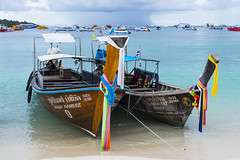 MayaBay (Zahidur Rahman ( Will be back soon )) Tags: ocean wood travel pink flowers blue roof red sea orange cloud brown white flower green tourism beach colors yellow skyline landscape thailand boats 50mm bay sand aqua paradise view maya flag stamp clothes canvas fabric serene ribbon watercolors nikkor phuket krabi tyres tyre cleanwater texts phiphidon mayabay skurf krabiislands nikond610 phiphiislandspeedboatsky chokvirat nusinnamchot