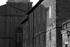 architectural forms and movements, shade, Pienza, Tuscany, Italy, Nikon D40, nikon nikkor 55mmf-3.5, 11.2.15 (steve aimone) Tags: blackandwhite italy monochrome architecture tuscany pienza movements rhythms primelens nikond40 nikonprime architecturalforms nikonnikkor55mmf35 architeccturalmovements